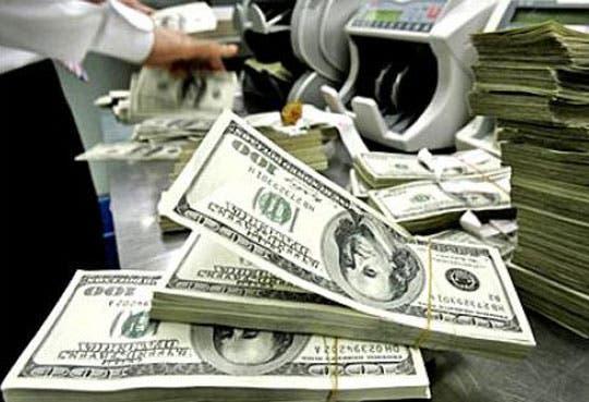 201303011447401.contando-dolars.jpg