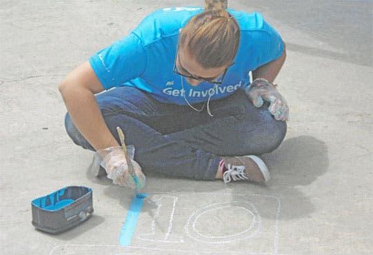 Voluntarios embellecen escuela de Los Guido