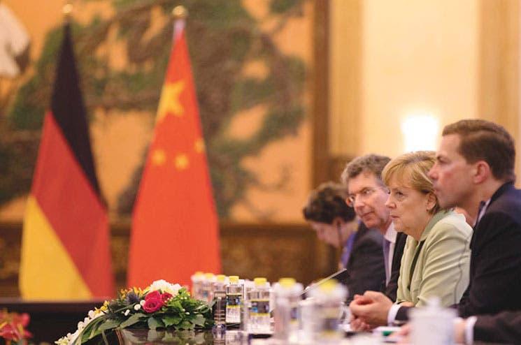 Merkel logra millonarios acuerdos en visita a China