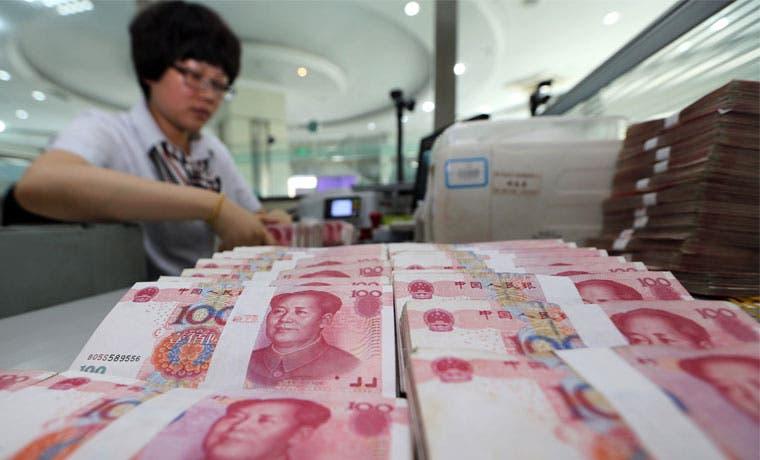 China devalúa por desaceleración