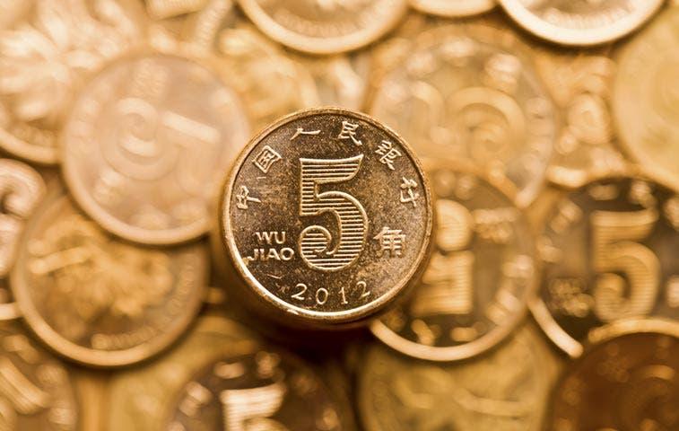 Devaluación del yuan chino impulsa caída mundial de monedas