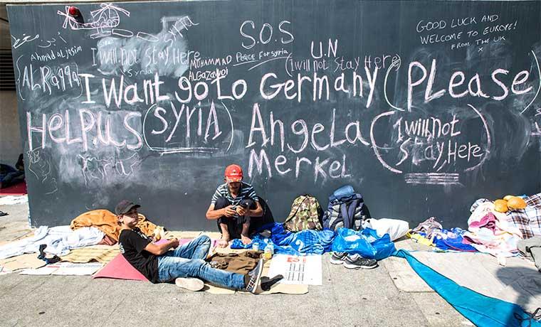 Aceptan solución de Merkel para refugiados