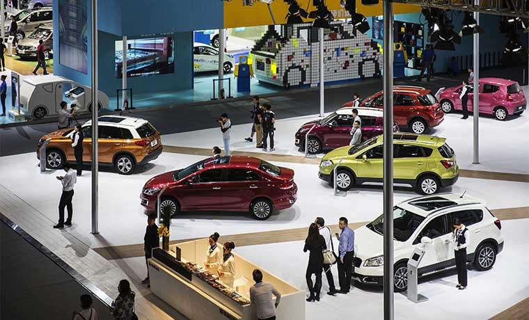 Fabricantes de autos en expo china ven nueva era de menos ventas
