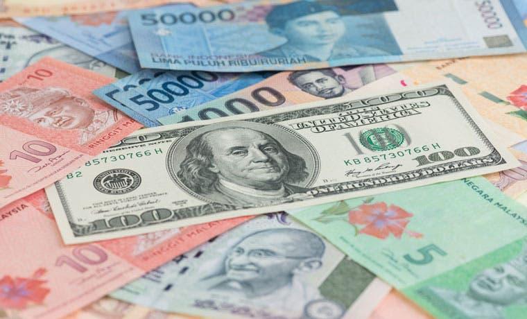 Monedas de mercados emergentes prolongan mejor mes en 18 años