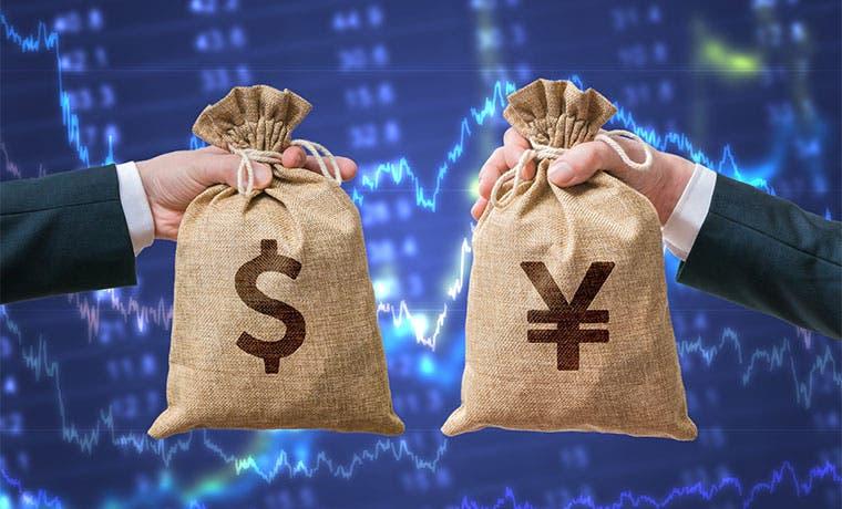 Yen baja por postergación de impuesto y mercado apuesta al dólar
