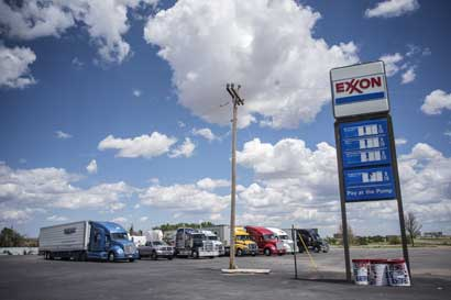 Exxon Mobil nombra CEO a Darren Woods para sustituir a Tillerson