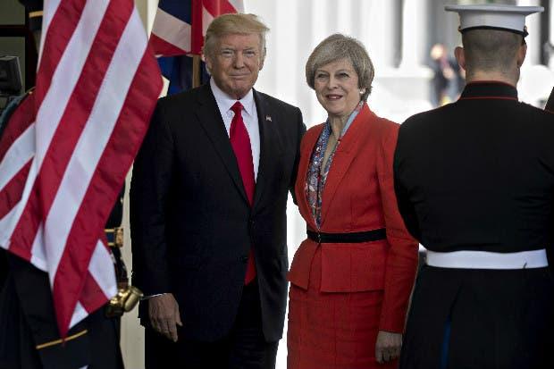 May pregona libre comercio en EEUU mientras Trump agita a México