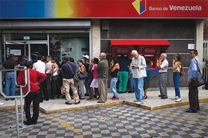 Venezuela se hunde más en terreno chatarra tras rebaja de S&P