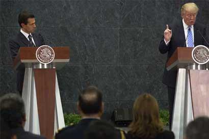 Trump pidió a Peña Nieto que buscara una fórmula para pagar por el muro