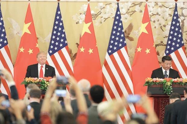Trump denuncia comercio chino injusto pero culpa a predecesores