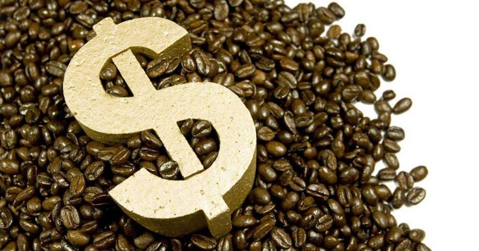 granos de café y signo de dólar