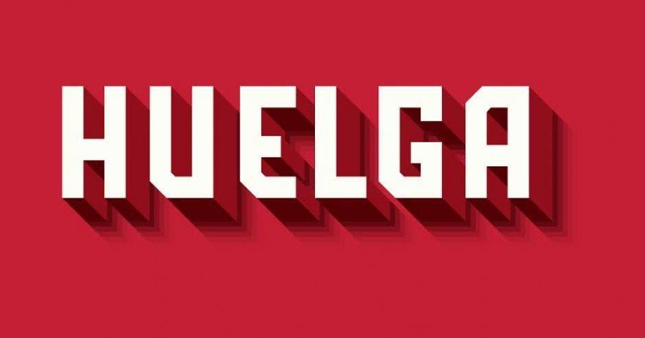 La palabra huelga en color blanco sobre un fondo rojo