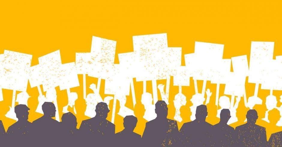 Personas sostienen pancartas en consigna de huelga