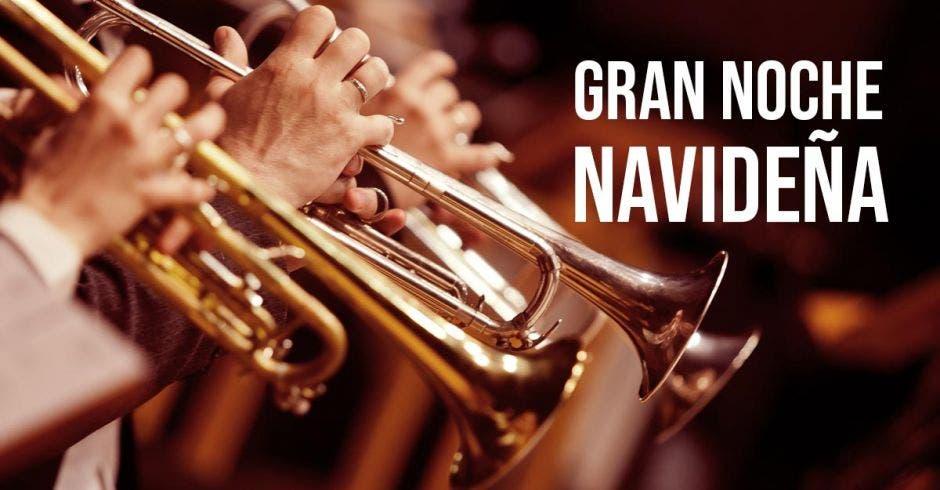 """Foto de varios trompetistas y al lado en letras blancas """"Gran Noche Navideña""""."""