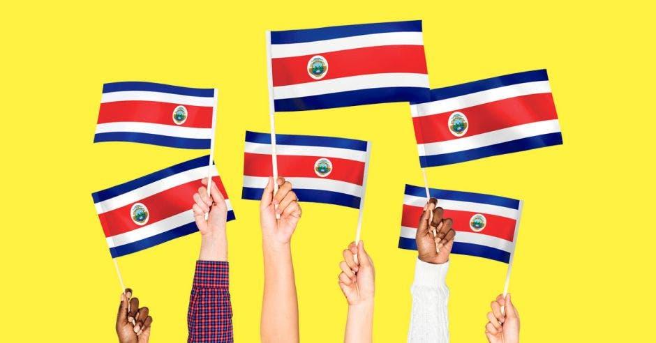 Una imagen que muestra manos con banderas de Costa Rica.
