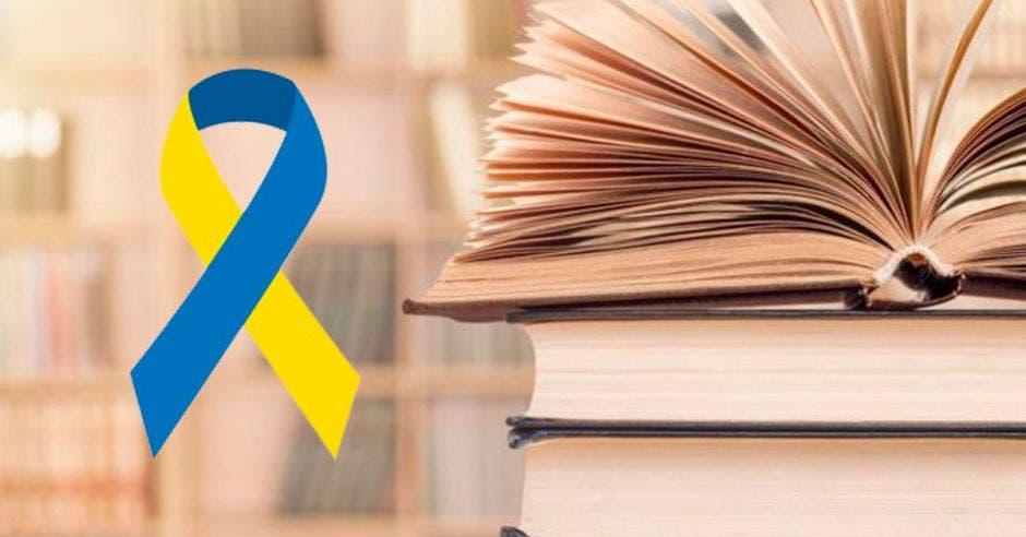 Un libro y un lazo amarillo con azul