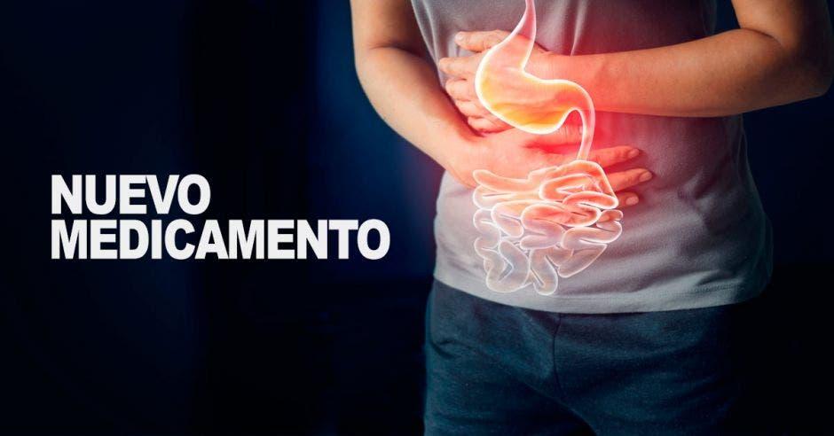 Una persona sosteniendo su estómago y un dibujo de los órganos