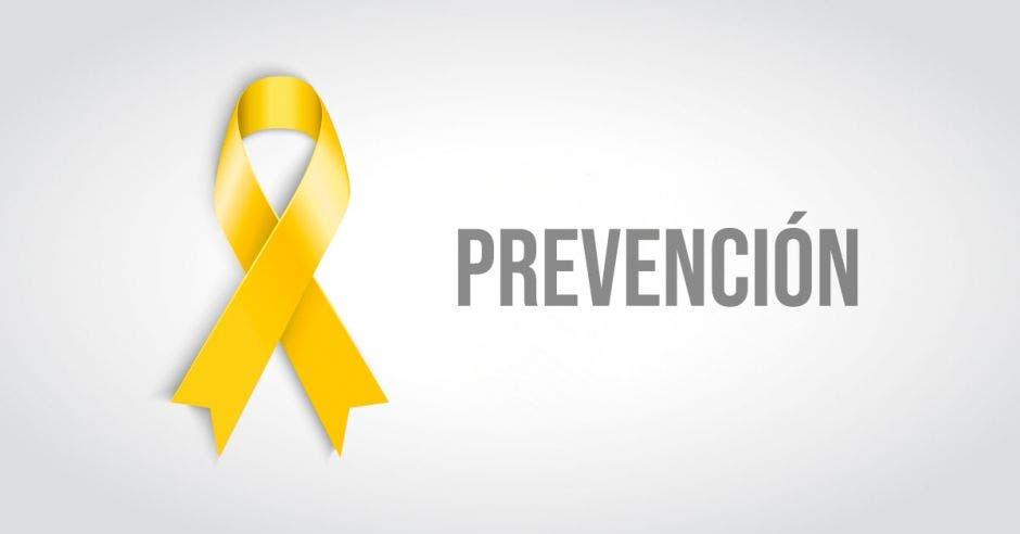 Un lazo amarillo y la palabra prevención