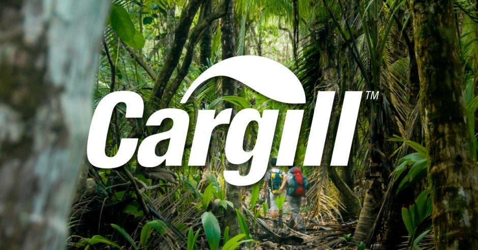 Logo del Cargill, fondo de árboles