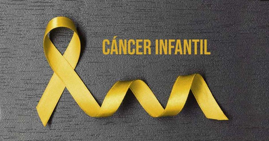 Un lazo amarillo con la palabra cáncer infantil