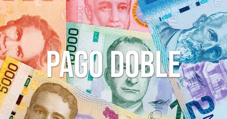 Varios billetes de Costa Rica con la palabra PAGO DOBLE