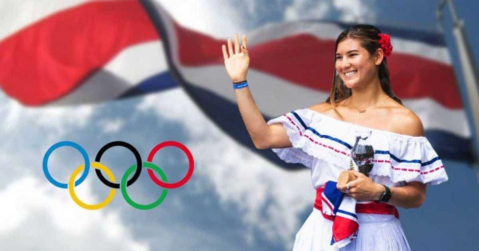 brisa hennessy con traje típico y bandera y aros olímpicos