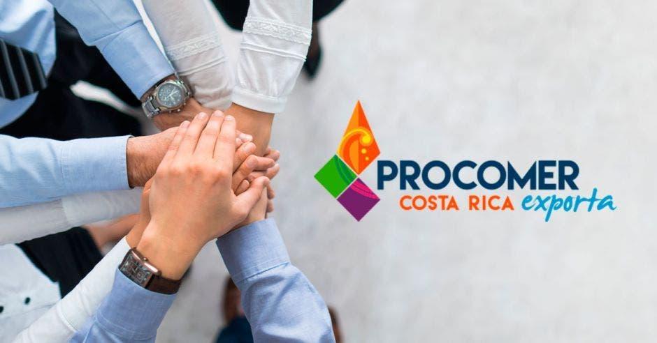 manos  unidas con logo  de Procomer Costa Rica Exporta