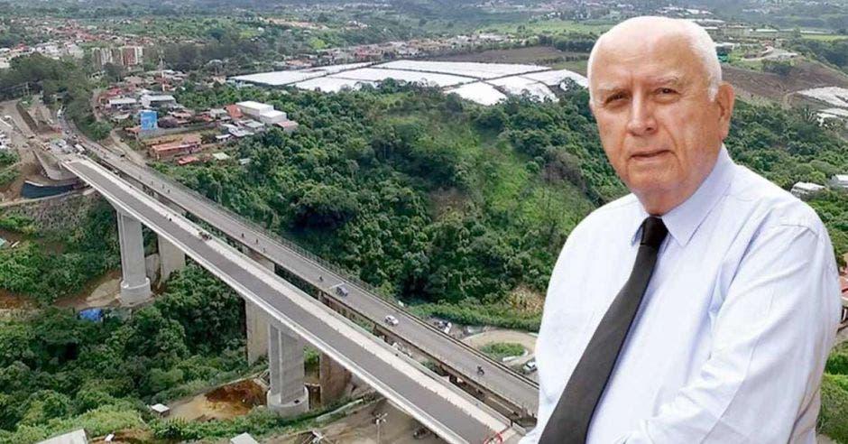 Arte de Rodolfo Méndez, ministro de Obras Públicas, con puente del Saprissa de fondo