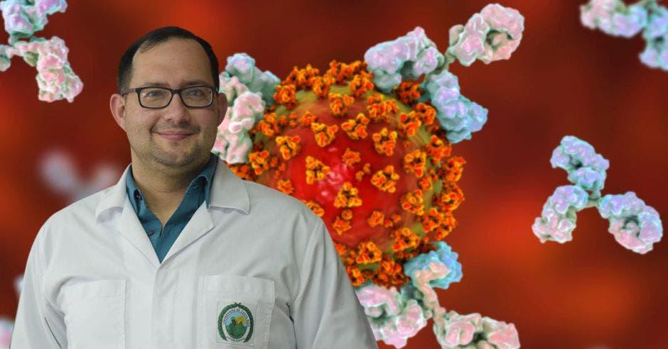 German Madrigal, director del Instituto de Investigaciones Farmacéuticas-UCR y un fondo de un coronavirus atacado por anticuerpos