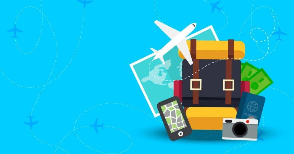avión vuela sobre maletas y otros artículos de viaje como cámara, mapa y celular.