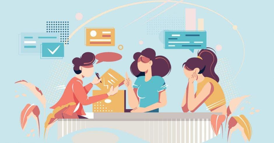 Un grupo de mujeres discute ideas alrededor de una mesa