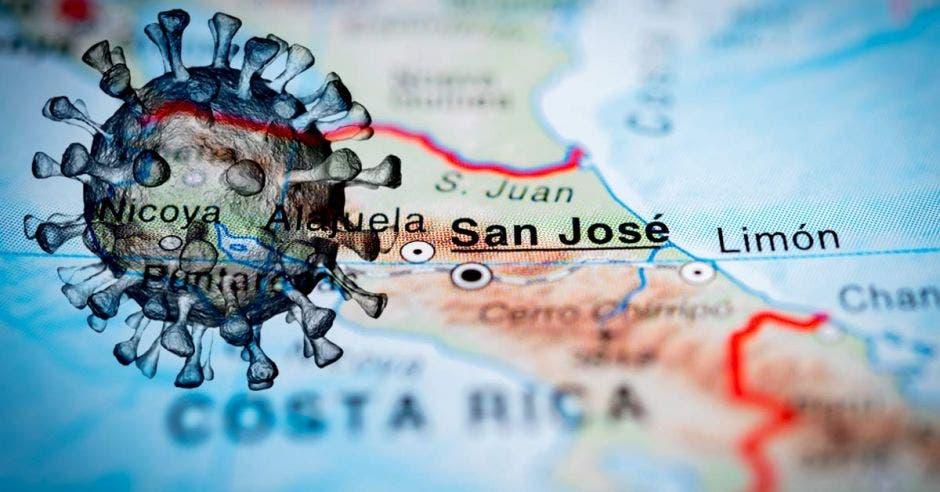 Una figura de Covid-19 y un mapa de Costa Rica