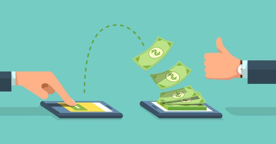Persona pasando dinero de un celular a otro