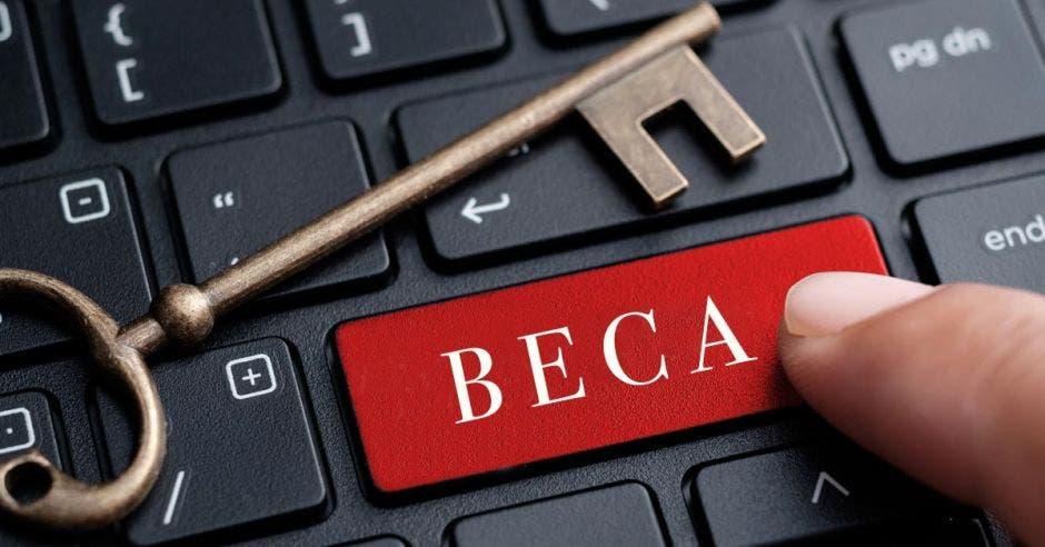 Palabra Beca en tecla de computadora