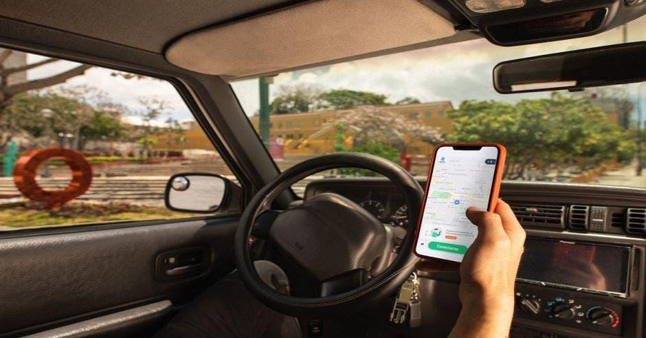 Conductor utilizando app de DiDi