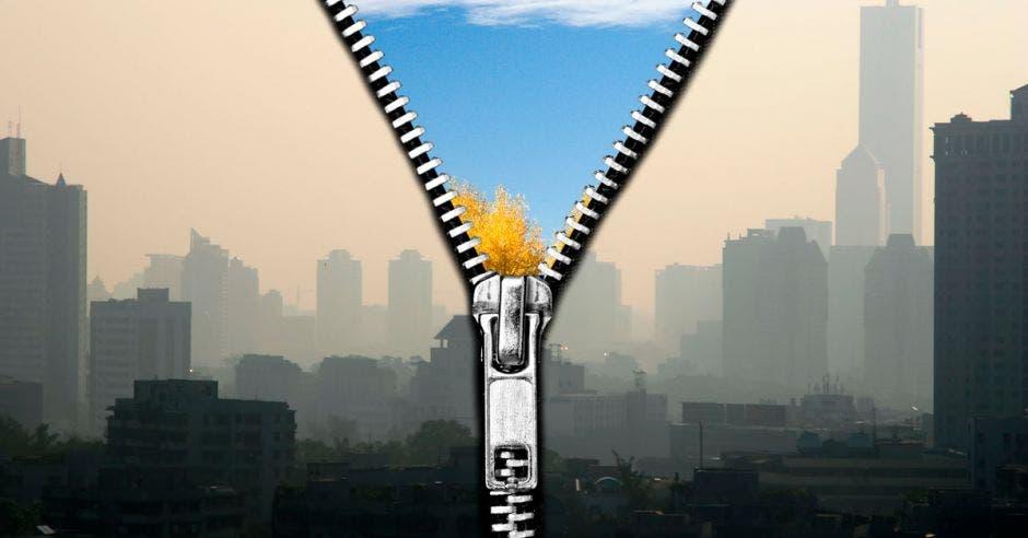 un zipper sobre una ciudad llena humo, abriéndola a la mitad y revelando un cielo azul