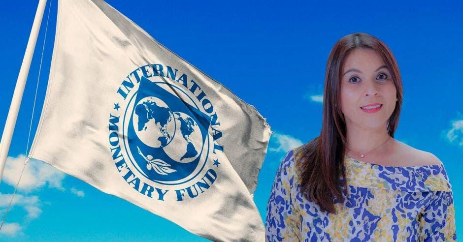Mujer delante de bandera del FMI