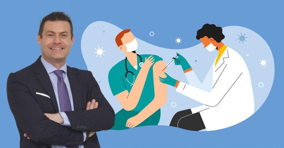 Massimo Manzi y un dibujo de un doctor vacunando a otro