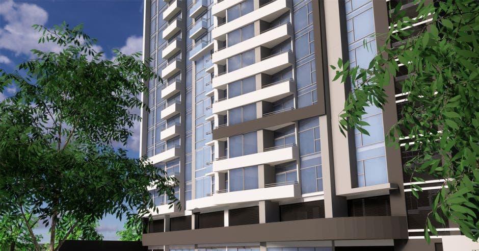 una torre de apartamentos con múltiples cristales en la fachada