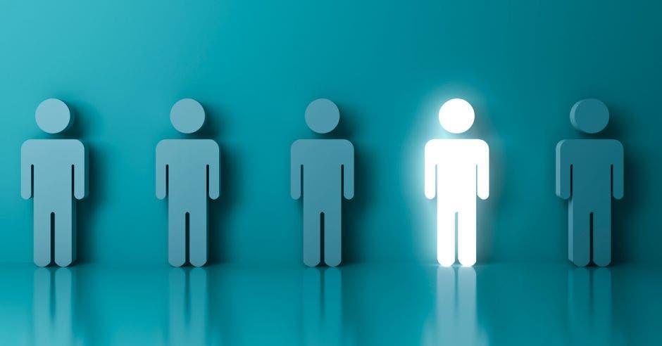una fila de íconos de personas sobre un fondo azul