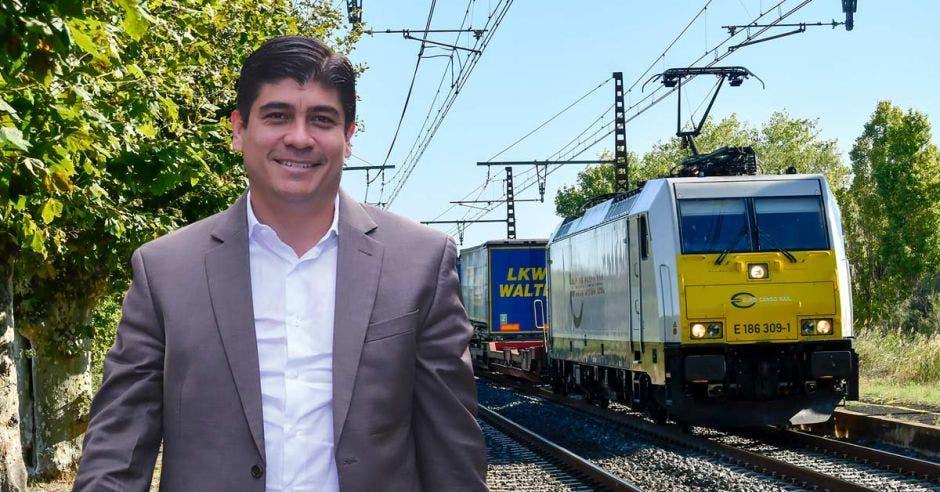 Un arte que muestra un tren eléctrico de carga y al presidente Carlos Alvarado al lado