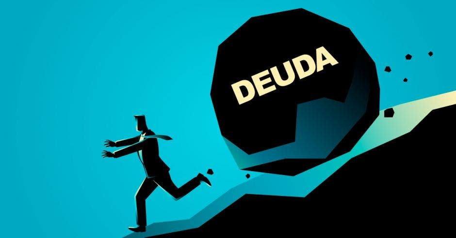 Persona corre colina abajo con bola de piedra gigante siguiendo con la palabra deuda