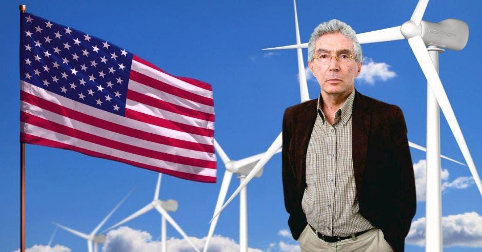 un hombre de edad avanzada sobre un fondo de molinos de viento y una bandera de los Estados Unidos