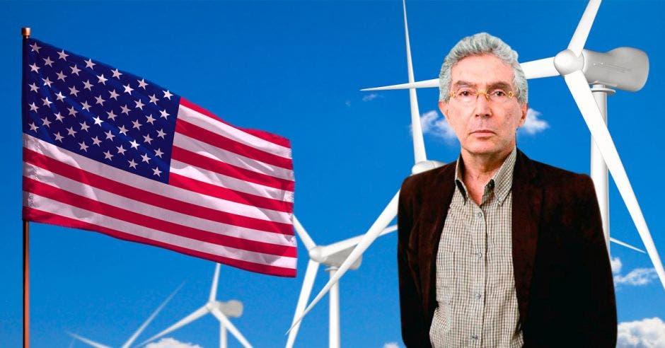 un hombre de camisa y saco sobre el fondo de la bandera de los estados unidos y varias torres eólicas