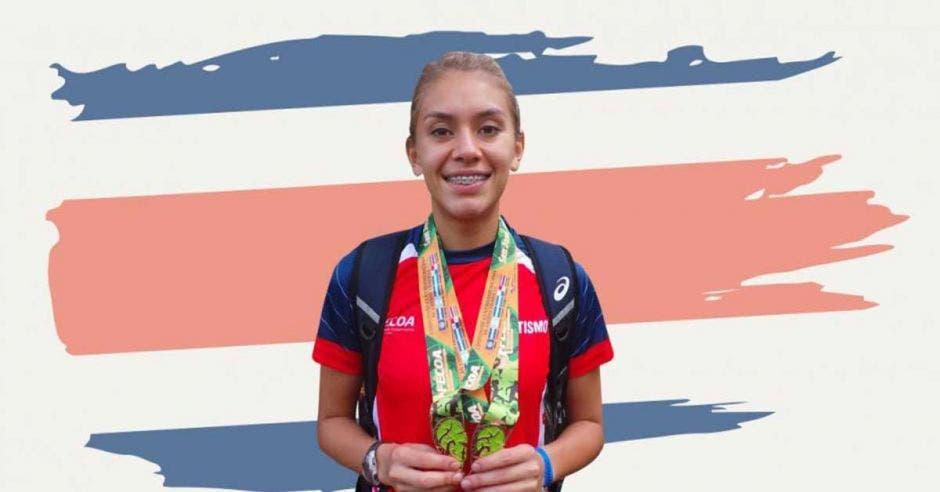 Noelia vargas con medalla y fondo de bandera
