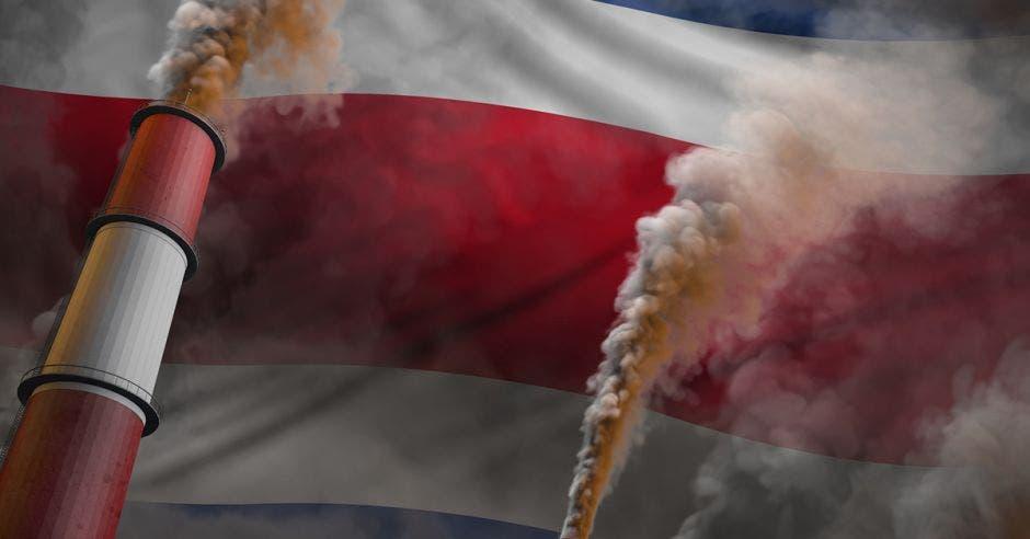 dos fumarolas salen de una bandera color azul, blanco y rojo. Concepto de cambio climático.