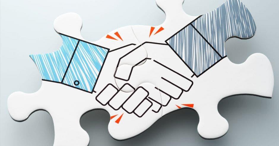 un rompecabezas de dos personas dándose la mano