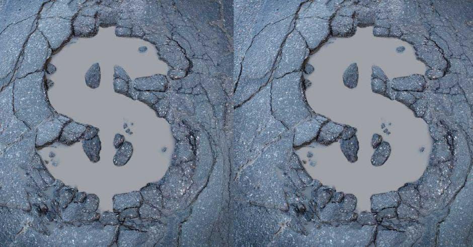 Un arte con dos señales de dólar dibujadas en una carretera en mal estado