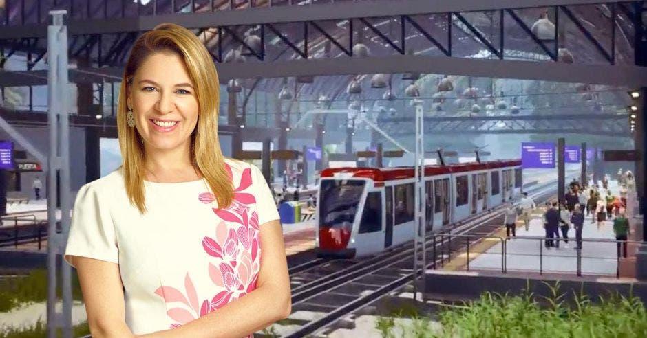 La primera dama Claudia Dobles, con un fondo de como sería la estación del tren eléctrico